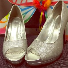 HIGH HEELS SILVER SHOES super cute and stylish silver high heels. fancy enough for weddings and formal, prom, even date.... but not too fancy that you can't wear with jeans and a cute top. originally bought it for a wedding, worn once.... like new. Rampage Shoes Heels