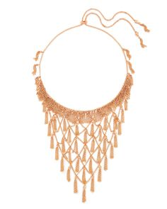 The Georgina Statement Necklace in Rose Gold from Kendra Scott combines layers of delicate, metallic chain details with an adjustable sliding bead closure.