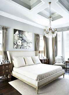 window drapes on both sides of the bed and the far wall. crown moulding