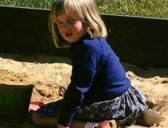 Diana plays in the sand pit
