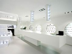 This Freudenhaus Eyewear Store was designed by Aigner Architecture. The overall design follows the idea of simplicity and high quality of the product itself.  Clear lines, simple forms and high-quality materials provide a superior stage for displaying the designer glasses. The…