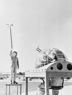 """""""A South African Air Force instructor trains prospective air gunners on the camera gun by manoeuvring a model aircraft on a long pole."""" (via)"""