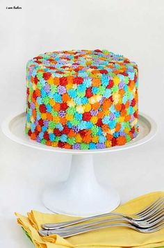 Colorful Cake...  Grass tip creates little tufts that look like pom poms all over cake