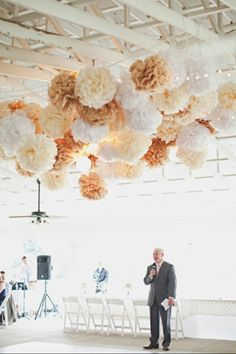 Paper Pom Pom decor elegant but inexpensive way to decorate a wedding