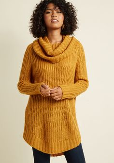 <p>A return trip to your northern roots is the perfect opportunity to debut this mustard sweater. Meeting with old pals, classmates, and family is made all the better with the cozy cowl neck, vented sides, and oversized fit of this essential pullover, because its look always prompts a warm welcome!</p>