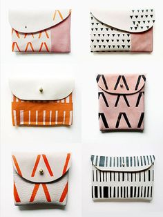 so wish these were not leather:(  Leather and suede clutch purses handcrafted by illustrator Peggy Wolf