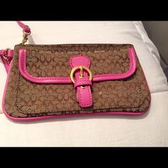 Coach Wristlet Coach signature wristlet inspired-colors pink, tan and light brown. It is light weight, comfortable and extremely stylish for yourself or to give as a gift. It is pre/owned but is in excellent condition. Coach inspired Bags Clutches & Wristlets