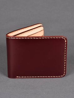 Iron Heart Small Shell Cordovan Wallet - Oxblood -Japanese Shell Cordovan leather -Oxblood -Inner cream calf leather  -Hand-stitched -Removable centre credit card leaf -8 card slots on each side of main body -Crafted in Japan