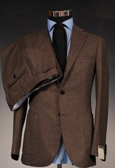 .There was a time when the brown suit was a cliche and dull. The right texture and materials makes it a modern classic.