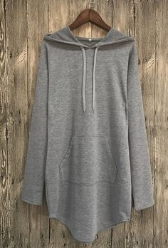 A knit hoodie featuring an oversized silhouette, a drawstring hood, and long sleeves. Perfect match your ripped denim pants.