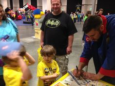 Master Builder Chris signs autographs for some happy attendees.