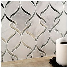 Beautiful Asian Statuary paired with glass creates this striking design that will provide any room with a sleek, stylish and contemporary appearance. Shop these tiles and more at TileBar.com!