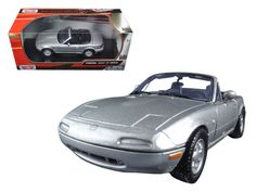 Mazda Miata MX-5 Silver 1/24 Diecast Model Car by Motormax - Brand new 1:24 scale diecast model car of Mazda Miata MX-5 Silver die cast car model by Motormax. Brand new box. Rubber tires. Made of diecast with some plastic parts. Detailed interior, exterior. Has opening hood, doors and trunk. Dimensions approximately L-7, W-3.25, H-2.75 inches. Please note that manufacturer may change packing box at anytime. Product will stay exactly the same.-Weight: 2. Height: 5.5. Width: 6. Box Weight: 2…