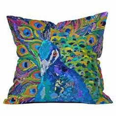 Add a pop of color to your sofa, arm chair, or windowseat with this delightful pillow, showcasing a peacock motif.    Product: PillowConstruction Material: Woven polyester cover and polyester fillColor: MultiFeatures:  Insert includedDesigned by Elizabeth St Hilaire Nelson for DENY DesignsSix color dye process, custom printed for every orderSealed closureMade in the USA Cleaning and Care: Spot treat with mild detergent