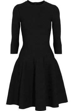 A trained couturier and sculptor, Azzedine Alaïa's silhouettes enhance your figure and are supremely comfortable to wear. This black mini dress is cut from a shape-holding jacquard-knit that fits smoothly against the bust, waist and hips before flaring out into soft pleats at the skirt. We like it best with ladylike pumps.