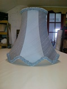 Shade recovered in Linwood Jem silk, finished off with ruched handmade trimming.