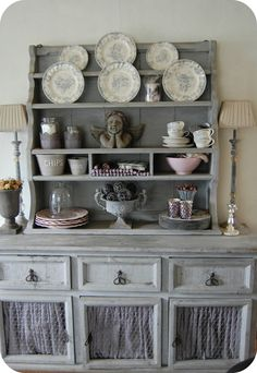 a piece like this could be created by stacking…I have seen lots of pieces that could be painted, have door panels removed, curtains and mesh…with a similar piece painted to match and stacked on top- voila!