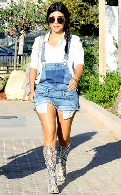 "The pregnant reality star rocks a pair of '90s-style short denim overalls and eye-catching gladiator sandals while walking in Malibu, California after attending baby North West's ""Kidchella 2014"" first birthday party"