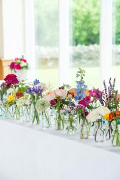 I love flowers of any sort, but in this picture they have styled a row of small jars filled with short stemmed fresh flowers. Easily re-creatable and accessible. The plain table cloth gives an idea that perhaps this could be for a village show.. but I love the idea of home grown flowers in the home. The photo is styled away from you - drawing your eye towards the end of the table so you don't miss anything. #bywstudent