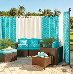 Transforming an outdoor living space with freestanding curtains.