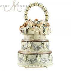 Mary Frances beaded embellished bridal handbags fuse whimsy with elegance, femininity with functionality. Richly embellished with opulent natural stones and trims from all over the world, each piece is handcrafted in intricate detail. Bridal Handbags, Unique Handbags, Purses And Handbags, Handbags Online, Mary Frances Purses, Mary Frances Handbags, Beaded Wedding Cake, Wedding Cakes, Novelty Handbags