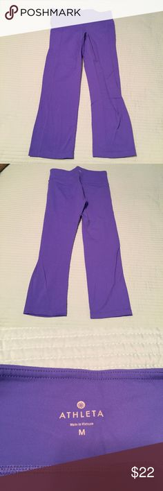 Athleta capris Sports/yoga capris by Athleta. Sweat wicking, technical fabric in electric blue. Small key pocket on inside of waist band. In excellent used condition. Size Medium. Athleta Pants Leggings