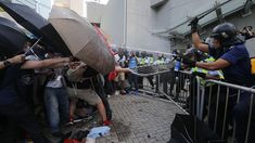 """The ongoing pro-democracy demonstrations in Hong Kong have co-opted an unusual symbol: the umbrella. After the publishing of striking images of front-line protestorsparrying jets of pepper spray with nylon shields, social media began dubbing the protests the """"Umbrella Revolution"""" and the """"Umbrella Movement."""" The protestor in one photo, arms and umbrella raised amidclouds of tear..."""