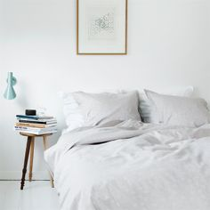 white bedding, white walls