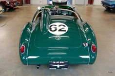 Period Le Mans Style ExteriorModified 1.6L w/90 HPCorrect Green LiveryWith Le Mans style looks, this 1959 MGA is presented in Racing Green and complemented by a tan leather interior, all in exceptional condition. All gauges are clean, clear and operate as they should. Outwardly the MGA has the Lemans look, with deleted front and rear bumpers, leather hood tie downs, a faired-in headrest, cut-down windscreen, and fender-mounted racing mirrors. The MGA has bee...