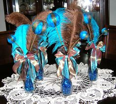 Peacock Wedding Table Centerpiece Decoration via Etsy..no brown feathers though