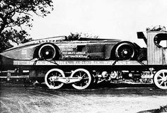 The record-breaking racing car on the back of a steam road wagon built at the Sentinel works. Could this be the worlds first Racecar Transporter ???