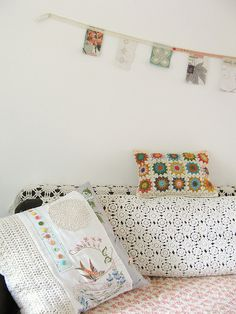 those cushions and that lovely lacey coverlet and the itty bitty banner