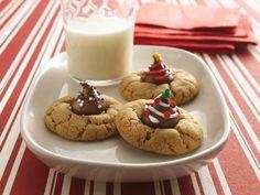 Festive Peanut Butter Blossom Cookies using @Paul Hirschi'S Chocolate Kisses!