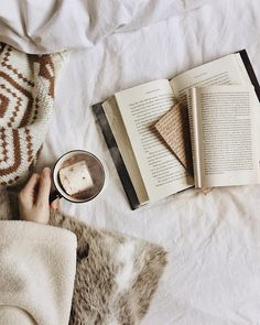 """J Lucan   Est. 1996 (@dorkyball) on Instagram: """"Happy Wednesday! Spending the snowy morning in bed with my current read and a cup of hot cocoa n…"""" [ #cocoa #hotcocoa #hotchocolate #hotdrink #marshmallow #breakfast #bestofvegan #cozy #cosy #cozyvibes #vsco #vscocam #whitefeed #flatlay #currentlyreading #bookstagram #bibliophile #bookworm #bookporn #booknerd #Booklover #booklove #bookaholic #bookphotography #books #bookish #reading #bookishfeatures #photooftheday ]"""
