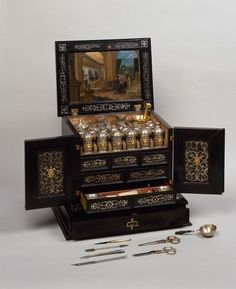 Peter the Great's (1672-1725) travelling medicine chest, Augsburg, Tobias Lenghardt and Hans Georg I Brenner, 1613–15, Wood, copper, steel, silver, glass, silk, velvet, braid; oil paint on copper, ebony veneer, gilding. 39.5 x 41 x 32.5 cm © State Hermitage Museum, St Petersburg