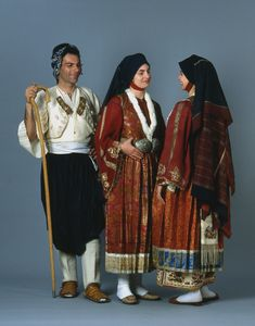 Three costumes from Skyros, Northern Sporades island, a man's shepherd costume and two festive-bridal dresses made of brocade. Late 19th to early 20th c. © Peloponnesian Folklore Foundation, Nafplion, Greece