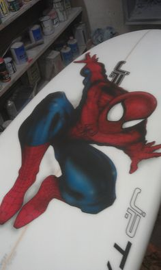 Spiderman spiderman does every thing a spider can! like sticking to a surfboard. i did this on the bottom so the detail isn't obscured by wax on the deck