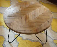 Round chevron patterned coffee table - a modern piece handcrafted out of reclaimed barn wood and steel hairpin legs