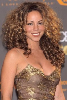The bigger the better - Mariah Carey makes the list of  top 18 diva hairstyles of all time.