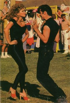 """Grease! Olivia Newton John's black catsuit and Travolta's grease monkey chic are THE BUSINESS. Even the Candies """"werk""""... ;-)"""