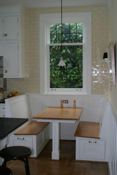 drawers built into breakfast nook seating - it's like having a diner in your kitchen