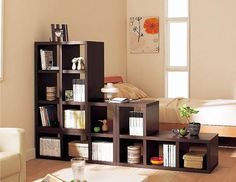 I like the idea of having book shelves around the bed. This could separate the bed in a large loft-like room
