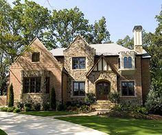 English Country Manor. That large section on the left doesn't have to be a garage. It doesn't.