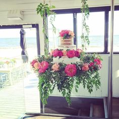 3 toned hanging wedding cake, naked sponge cake, semi naked sponge cake and buttercream cake. with fresh flowers, suspended from the rafters with a magical beach view #regniercakes #wedding #weddingcake #weddingcakes #weddingcakemelbourne #weddingcakesmelbourne #dessert #dessertcake #dessertweddingcake #dessertweddingcakes #freshflowers #hangingcake #hangingcakes #suspendedcake #nakedweddingcake #nakedcake #seminakedcake today's hanging wedding cake @sandbarbeachcafe