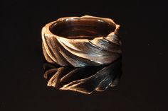Just love this piece! Man's wedding ring carved and cast in 22kt red gold.  The textured wedding band is luscious!