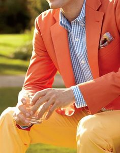 Shop this look on Lookastic: http://lookastic.com/men/looks/orange-blazer-white-and-blue-dress-shirt-yellow-chinos-multi-colored-pocket-square/11385 — White and Blue Gingham Dress Shirt — Multi colored Paisley Pocket Square — Orange Blazer — Yellow Chinos