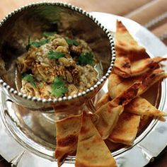 Baba Ghannouj with Tahineh by Saveur. Made of roasted eggplant, this widely recognized dip is tangy with a little spice.