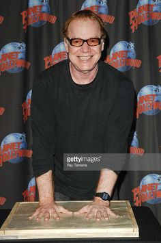 Composer Danny Elfman celebrates his first collaboration on a new ballet for American Ballet Theater by cementing his handprints for the Wall Of Fame at Planet Hollywood Times Square on June 4, 2008 in New York City.