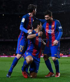 Luis Suarez of FC Barcelona celebrates with his team mate Sergi Roberto (L) and Lionel Messi of FC Barcelona after scoring his team's first goal during the Copa del Rey round of 16 second leg match between FC Barcelona and Athletic Club at Camp Nou on January 11, 2017 in Barcelona, Catalonia.