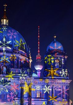 Berlin Cathedral and Television tower illuminated during the yearly Festival of Lights
